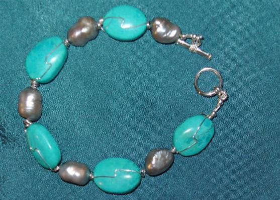 Bracelet Sterling silver wrapped turquoise with silver cultured freshwater pearls.