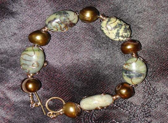 Bracelet Wire wrapped yellow turquoise with gold cultured freshwater pearls.  Both the wire and